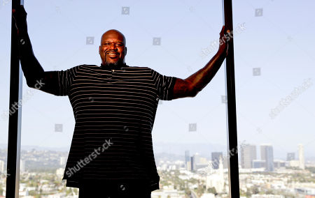 "Shaquille O'Neal poses for a picture in Los Angeles. The basketball icon-turned-TV personality is adding poetry to his resume as one of the stars of the new public television series ""Poetry in America"