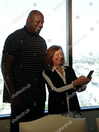 "Shaquille O'Neal poses for a selfie with with Harvard professor Elisa New in Los Angeles. The basketball icon-turned-TV personality is adding poetry to his resume as one of the stars of the new public television series ""Poetry in America,"" hosted by New"