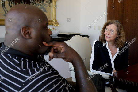 "Shaquille O'Neal, left, talks with Harvard professor Elisa New in Los Angeles. The basketball icon-turned-TV personality is adding poetry to his resume as one of the stars of the new public television series ""Poetry in America,"" hosted by New"