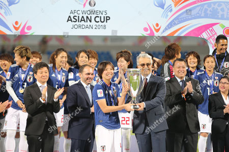 Sheikh Salman Bin Ibrahim Al-Khalifa, the President of the Asian Football  Delivers the tournament cup to Japan's player Saki Kumag after winning against Australia in the final soccer match at the 2018 AFC Women's Asian Cup in Amman, Jordan, 20 April 2018.