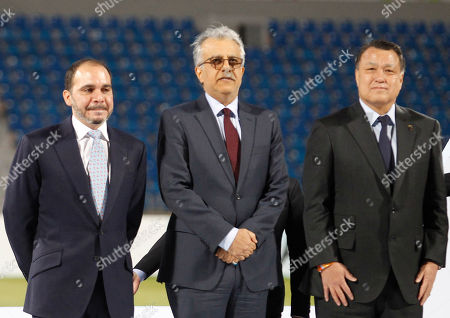 Jordan's prince Ali ben al hussain (L) President of the Japanese Football Federation Kozo Tashima (R) and Sheikh Salman Bin Ibrahim Al-Khalifa, the President of the Asian Football (C) after winning against Australia in the final soccer match at the 2018 AFC Women's Asian Cup in Amman, Jordan, 20 April 2018.
