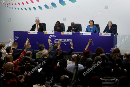 Journalists put their hands up to ask questions of, from left, Samoa Prime Minister Tuilaepa Aiono Sailele Malielegaoi, Grenada Prime Minister Keith Mitchell, Ghana President Nana Akufo-Addo, Secretary General of the Commonwealth Baroness Scotland and British Prime Minister Theresa May during the closing press conference for the Commonwealth Heads of Government Meeting (CHOGM) at Marlborough House in London