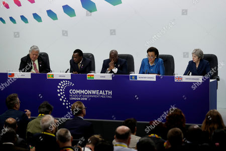 Secretary General of the Commonwealth Baroness Scotland, fourth left, answers a question flanked by, from left, Samoa Prime Minister Tuilaepa Aiono Sailele Malielegaoi, Grenada Prime Minister Keith Mitchell, Ghana President Nana Akufo-Addo and British Prime Minister Theresa May during the closing press conference for the Commonwealth Heads of Government Meeting (CHOGM) at Marlborough House in London