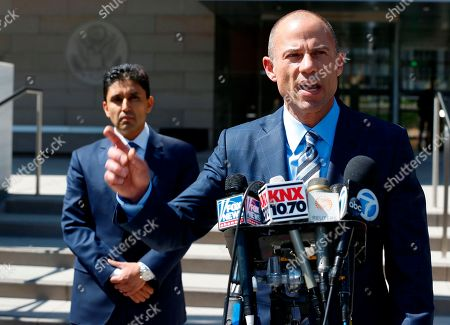 """Stormy Daniels' attorney, Michael Avenatti, right,talks to the media outside court in Los Angeles . Daniels, whose real name is Stephanie Clifford, has been seeking to invalidate a non-disclosure agreement she signed days before the 2016 presidential election and offered to return the $130,000 she was paid to """"set the record straight."""" U.S. District Judge James Otto will hold a hearing Friday morning in Stormy Daniels' case in Los Angeles. Daniels, whose real name is Stephanie Clifford, has been seeking to invalidate a nondisclosure agreement she signed days before the 2016 presidential election, so she can discuss the alleged relationship, which Trump denies. She argues it isn't valid because Trump's lawyer, Michael Cohen, signed it, but the president did not"""