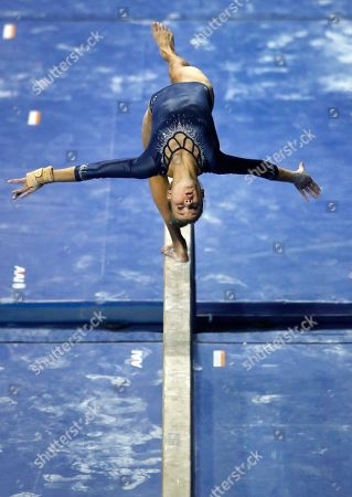 UCLA's Madison Kocian competes on the balance beam during the NCAA college women's gymnastics championships, in St. Louis