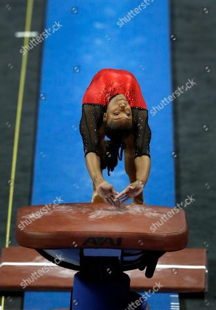 Stanford's Elizabeth Price competes on the vault during the NCAA college women's gymnastics championships, in St. Louis