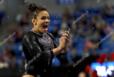 Georgia's Sabrina Vega applauds after competing in the floor exercise during the NCAA college women's gymnastics championships, in St. Louis