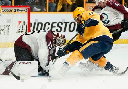 Colorado Avalanche goaltender Andrew Hammond (35) makes the save as Nashville Predators center Mike Fisher (12) drives to the net during the second period in Game 5 of an NHL hockey first-round playoff series, in Nashville, Tenn