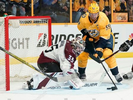 Nashville Predators defenseman Roman Josi (59) tries to get the puck past Colorado Avalanche goaltender Andrew Hammond (35) on a power play during the second period in Game 5 of an NHL hockey first-round playoff series, in Nashville, Tenn