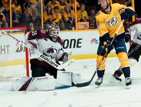 Nashville Predators center Colton Sissons (10) watches as a shot hits Colorado Avalanche goaltender Andrew Hammond (35) during the second period in Game 5 of an NHL hockey first-round playoff series, in Nashville, Tenn