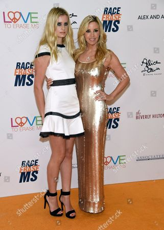 Mason Grammer, Camille Grammer. Mason Grammer, left, and Camille Grammer arrive at the 25th annual Race to Erase MS Gala at The Beverly Hilton hotel, in Beverly Hills, Calif