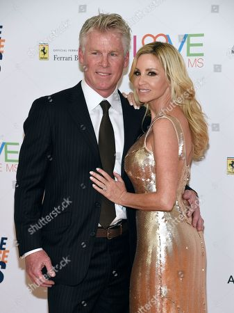 David C. Meyer, Camille Grammer. David C. Meyer, left, and Camille Grammer arrive at the 25th annual Race to Erase MS Gala at The Beverly Hilton hotel, in Beverly Hills, Calif