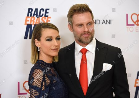 Natalie Zea, Travis Schuldt. Natalie Zea, left, and Travis Schuldt arrive at the 25th annual Race to Erase MS Gala at The Beverly Hilton hotel, in Beverly Hills, Calif