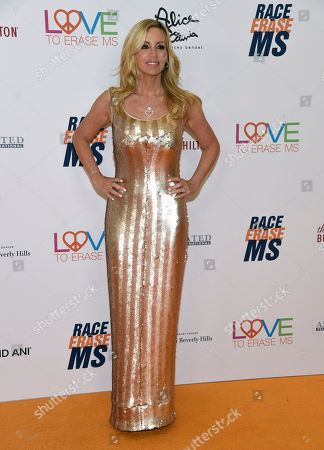 Camille Grammer arrives at the 25th annual Race to Erase MS Gala at The Beverly Hilton hotel, in Beverly Hills, Calif