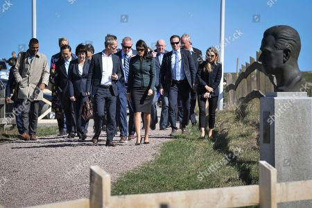 Sweden's ambassador to the United Nations Olof Skoog (front L) and United States Ambassador to the UN Nikki Haley (front R) and other members of the UN Security Council arrive for a meeting with UN Security Council meeting at Backakra outside Ystad, southern Sweden, 21 April 2018. The meeting on Syria will take place at Backakra, the estate of Dag Hammarskjold, who served as UN Secretary-General from 1953 until his death in a plane crash in September 1961.