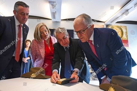 (L-R) Australian Veterans' Affairs Minister Darren Chester, Lucy Turnbull, Australian Prime Minister Malcolm Turnbull and Ross Fuller take a look at the pocket bible of the late Corporal Alexander John Robert Ross during a donation ceremony at the Australian War Memorial at Hyde Park in London, Britain, 21 April 2018. Turnbull was attending the Commonwealth Heads of Government Meeting 2018 in London.