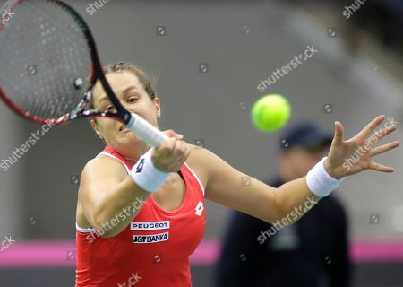 Jana Cepelova of Slovakia returns the ball to Aliaksandra Sasnovich of Belarus during the Fed Cup World Group play-off round tennis match between Belarus and Slovakia in Minsk, Belarus