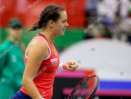 Jana Cepelova of Slovakia celebrates winning a point against Aliaksandra Sasnovich of Belarus during the Fed Cup World Group play-off round tennis match between Belarus and Slovakia in Minsk, Belarus