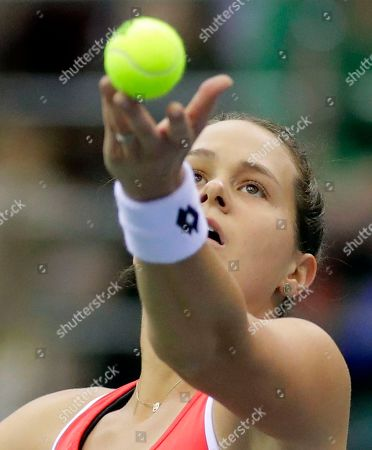 Jana Cepelova of Slovakia serves the ball to Aliaksandra Sasnovich of Belarus during the Fed Cup World Group play-off round tennis match between Belarus and Slovakia in Minsk, Belarus