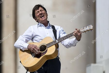 Italian singer Gianni Morandi perfoms during the special audience of Pope Francis with faithful coming from Bologna and Cesena, in St. Peter Square, Vatican City, 21 April 2018.