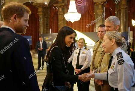 Britain's Prince Harry and Meghan Markle greet the Australian Defence Force during a reception hosted by Malcolm Turnbull, Prime Minister of Australia and his wife Lucy Turnbull at Australia House in London, to celebrate the forthcoming Invictus Games Sydney 2018