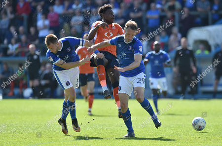 Danny Grainger of Carlisle United  and Clint Hill of Carlisle United block Pelly Ruddock of Luton Town