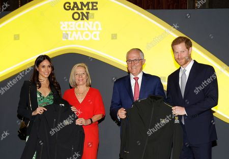 Prince Harry and Meghan Markle receive Invictus Games jackets from Malcolm Turnbull, Prime Minister of Australia and his wife Lucy Turnbull