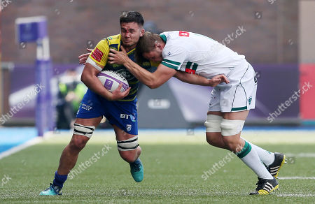 Ellis Jenkins of Cardiff Blues is tackled by Dave Foley of Pau.