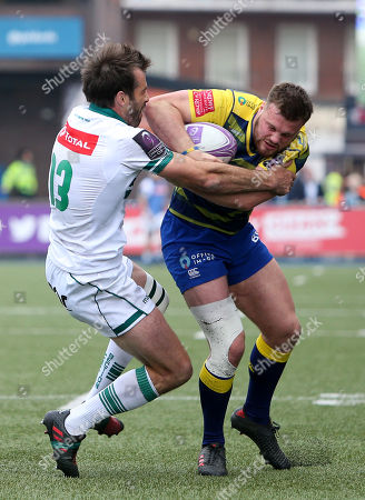 Stock Picture of Owen Lane of Cardiff Blues smashes past Conrad Smith of Pau.