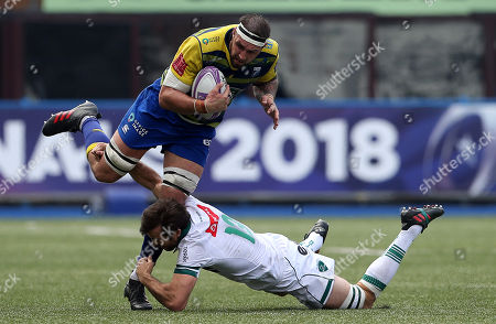 Josh Turnbull of Cardiff Blues is tackled by Conrad Smith of Pau.