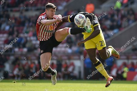 Sunderland midfielder Paddy McNair (4) battles for the ball with Burton Albion midfielder Hope Akpan (21) during the EFL Sky Bet Championship match between Sunderland and Burton Albion at the Stadium Of Light, Sunderland. Picture by Richard Holmes