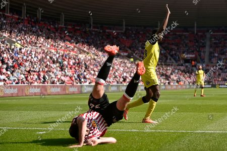 Burton Albion striker Lucas Akins (10) appeals for a decision whilst Sunderland defender Marc Wilson (36) takes a tumble during the EFL Sky Bet Championship match between Sunderland and Burton Albion at the Stadium Of Light, Sunderland. Picture by Richard Holmes