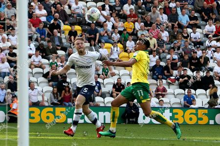 Preston North End defender Tom Clarke (5) and Norwich City midfielder Josh Murphy (11) during the EFL Sky Bet Championship match between Preston North End and Norwich City at Deepdale, Preston. Picture by Craig Galloway