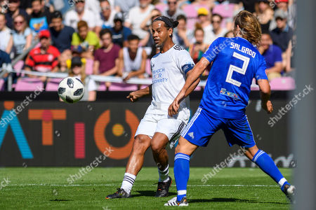 Brazilian former soccer player Ronaldinho (L) in action with Spanish former soccer player Michel Salgado during the 'Match for Solidarity', an UEFA-United Nations charity soccer match in Geneva, Switzerland, 21 April 2018. The match is aimed to raise money for the Sustainable Development Goals set out by the United Nations.
