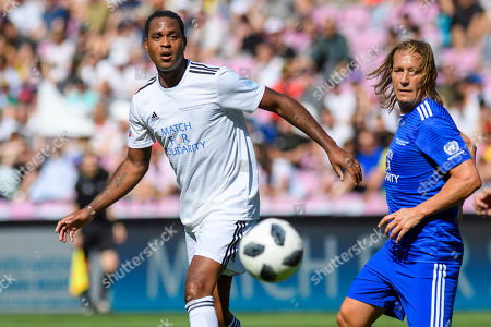 Dutch former soccer player Patrick Kluivert (L) fight for the ball with Spanish  former soccer player Michel Salgado during the 'Match for Solidarity', an UEFA-United Nations charity soccer match in Geneva, Switzerland, 21 April 2018. The match is aimed to raise money for the Sustainable Development Goals set out by the United Nations.