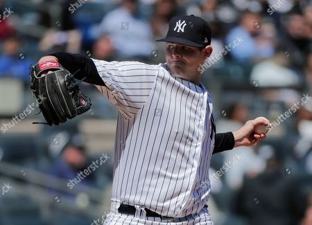 New York Yankees pitcher Jordan Montgomery delivers against the Toronto Blue Jays during the second inning of a baseball game, in New York