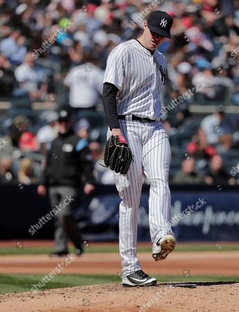 New York Yankees pitcher Jordan Montgomery reacts after giving up a run to the Toronto Blue Jays during the fifth inning of a baseball game, in New York