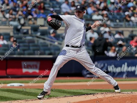 New York Yankees pitcher Jordan Montgomery delivers against the Toronto Blue Jays during the second inning of a baseball game, in New York. The Yankees won 9-1