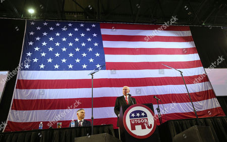 Utah U.S. Senator Orin Hatch speaks at the Utah Republican 2018 nominating convention as Chairman of the Utah Republican Party Rob Anderson, left, listens, in West Valley City, Utah. Mitt Romney is facing nearly a dozen Republican contenders in Utah on Saturday as he works to secure the state GOP nomination for a Senate seat without a primary