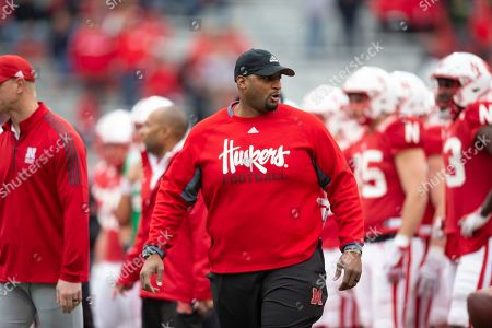 Nebraska offensive line coach Greg Austin working with the players before the Red/White spring football game game in Lincoln, Neb