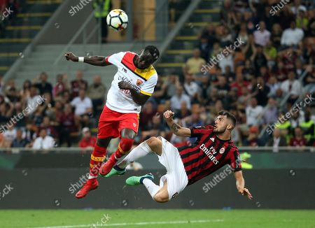 Milan's Patrick Cutrone (R) and Benevento's Bacary Sagna in action during the Italian Serie A soccer match AC Milan vs Benevento Calcio at Giuseppe Meazza stadium in Milan, Italy, 21 April 2018.