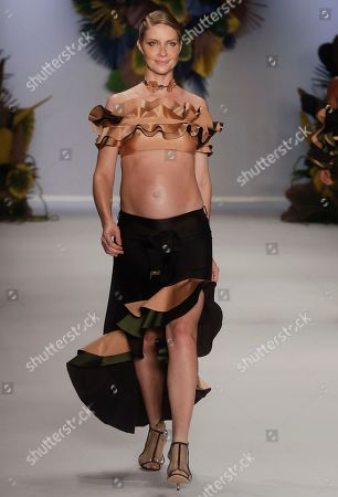 Pregnant Brazilian model Ana Claudia Michels wears a creation from the Agua de Coco collection during Sao Paulo Fashion Week in Sao Paulo, Brazil