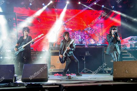 Heath, Richard Fortus, Toshi. Heath, from left, Richard Fortus of Guns N Roses, and Toshi of X Japan performs at the Coachella Music & Arts Festival at the Empire Polo Club, in Indio, Calif