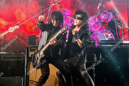 Stock Image of Richard Fortus, Toshi. Richard Fortus, left, of Guns N Roses, and Toshi of X Japan perform at the Coachella Music & Arts Festival at the Empire Polo Club, in Indio, Calif