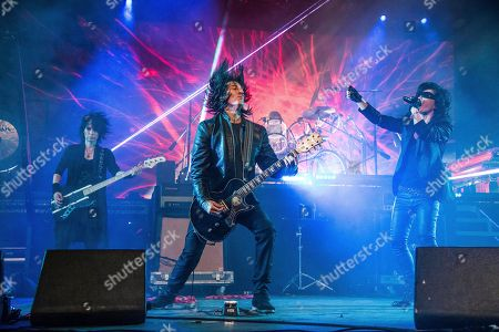 Heath, Richard Fortus, Toshi. Heath, from left, Richard Fortus of Guns N Roses, and Toshi of X Japan perform at the Coachella Music & Arts Festival at the Empire Polo Club, in Indio, Calif