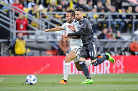 Columbus Crew SC midfielder Mohammed Abu (8) and New England Revolution defender Gabriel Somi (91) battle for the ball while sprinting in the first half of the match between New England Revolution and Columbus Crew SC at MAPFRE Stadium, in Columbus OH. ..Score - Columbus Crew SC 2 - New England Revolution 2 ..Mandatory Photo Credit: Dorn Byg/CSM