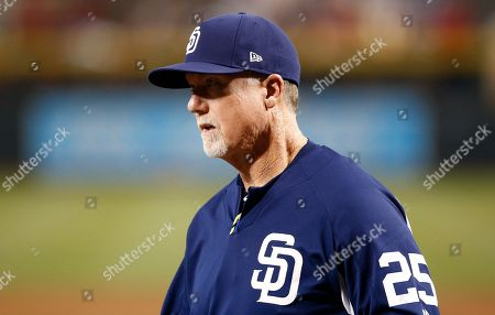 San Diego Padres bench coach Mark McGwire brings the lineup card to umpires at home plate prior to a baseball game against the Arizona Diamondbacks, in Phoenix. The Diamondbacks defeated the Padres 6-2
