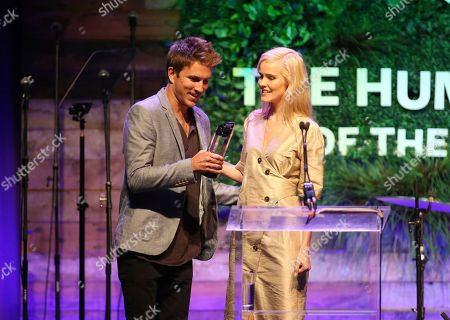 Isabel Lucas, Conrad Carr. Isabel Lucas, right, presents Conrad Carr with the Humane Hero Award at the Humane Society of the United States' To the Rescue! Los Angeles gala. The gala was held at Paramount Studios and benefitted the HSUS' Farm Animal Protection campaign. Competitive surfer Conrad Carr, undercover investigators Whitney Warrington and Mary Beth Sweetland, and law firm Latham & Watkins, LLP were honored at the event, which featured performances by Moby. (Photo by