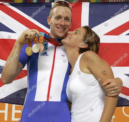 Olympic Games 2004. Great Britain Triple Cycling Medallist Bradley Wiggins With Gold Silver & Bronze Medals He Has Won With Fiancee Cath Cockran.