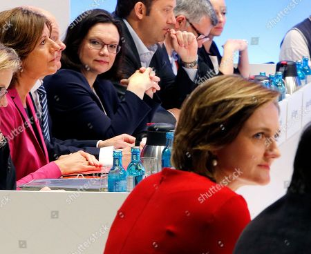 Candidates for SPD leadership Andrea Nahles, 2nd left, and Simone Lange sit in the plenum before the election during a party meeting of German Social Democrats in Wiesbaden, Germany